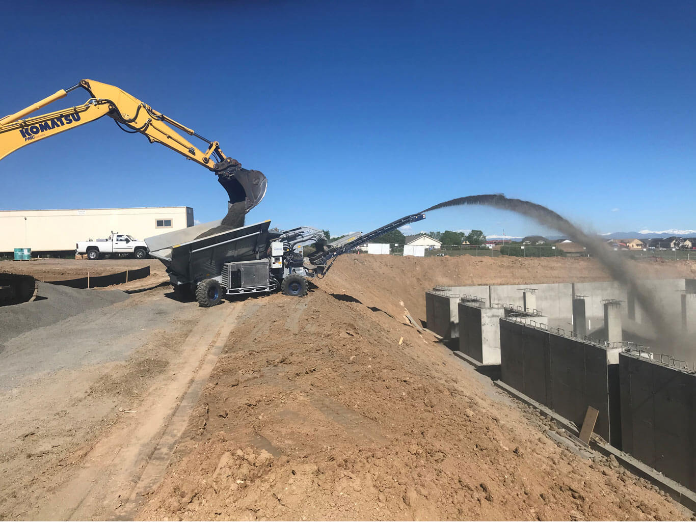Excavation backfill with a rock slinger truck in Centennial